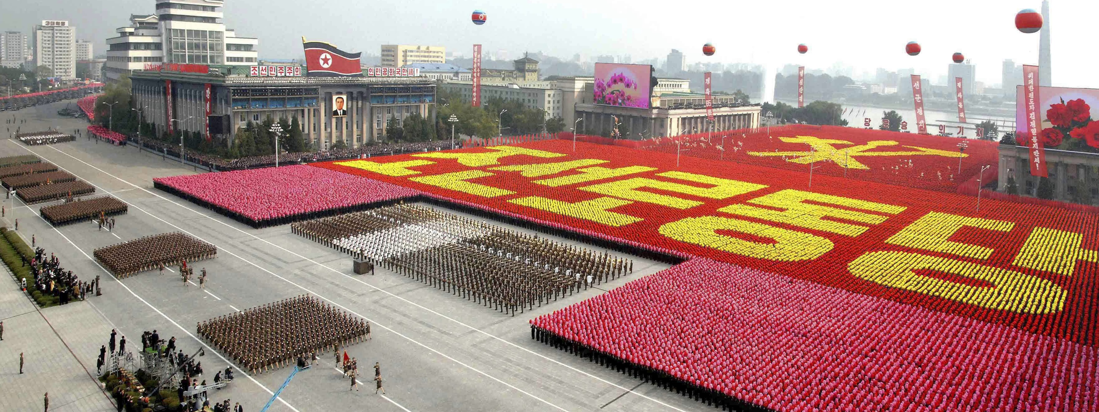 """A view of a parade to commemorate the 65th anniversary of the founding of the Workers' Party of Korea in Pyongyang in this October 10, 2010 file photo.  North Korean leader Kim Jong-il died on a train trip, state television reported on December 19, 2011 sparking immediate concern over who is in control of the reclusive state and its nuclear programme. A tearful announcer dressed in black said the 69-year old had died on December 17, 2011 of physical and mental over-work on his way to give """"field guidance"""".    REUTERS/KCNA/Files (NORTH KOREA - Tags: POLITICS MILITARY ANNIVERSARY OBITUARY) NO THIRD PARTY SALES. NOT FOR USE BY REUTERS THIRD PARTY DISTRIBUTORS"""