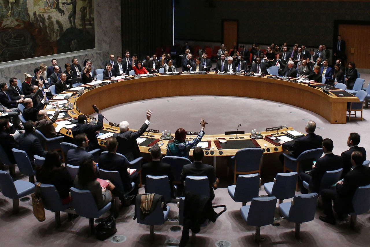 "The United Nations Security Council votes on resolution on humanitarian aid for Syria at U.N. headquarters in New York,     February 22,     2014. The U.N. Security Council on Saturday unanimously adopted a resolution to boost humanitarian access in Syria that threatens to take ""further steps"" in the case of non-compliance,     demands cross-border aid access and condemns rights abuses by the Syrian government and opposition armed groups. REUTERS/Eduardo Munoz (UNITED STATES - Tags: POLITICS)"