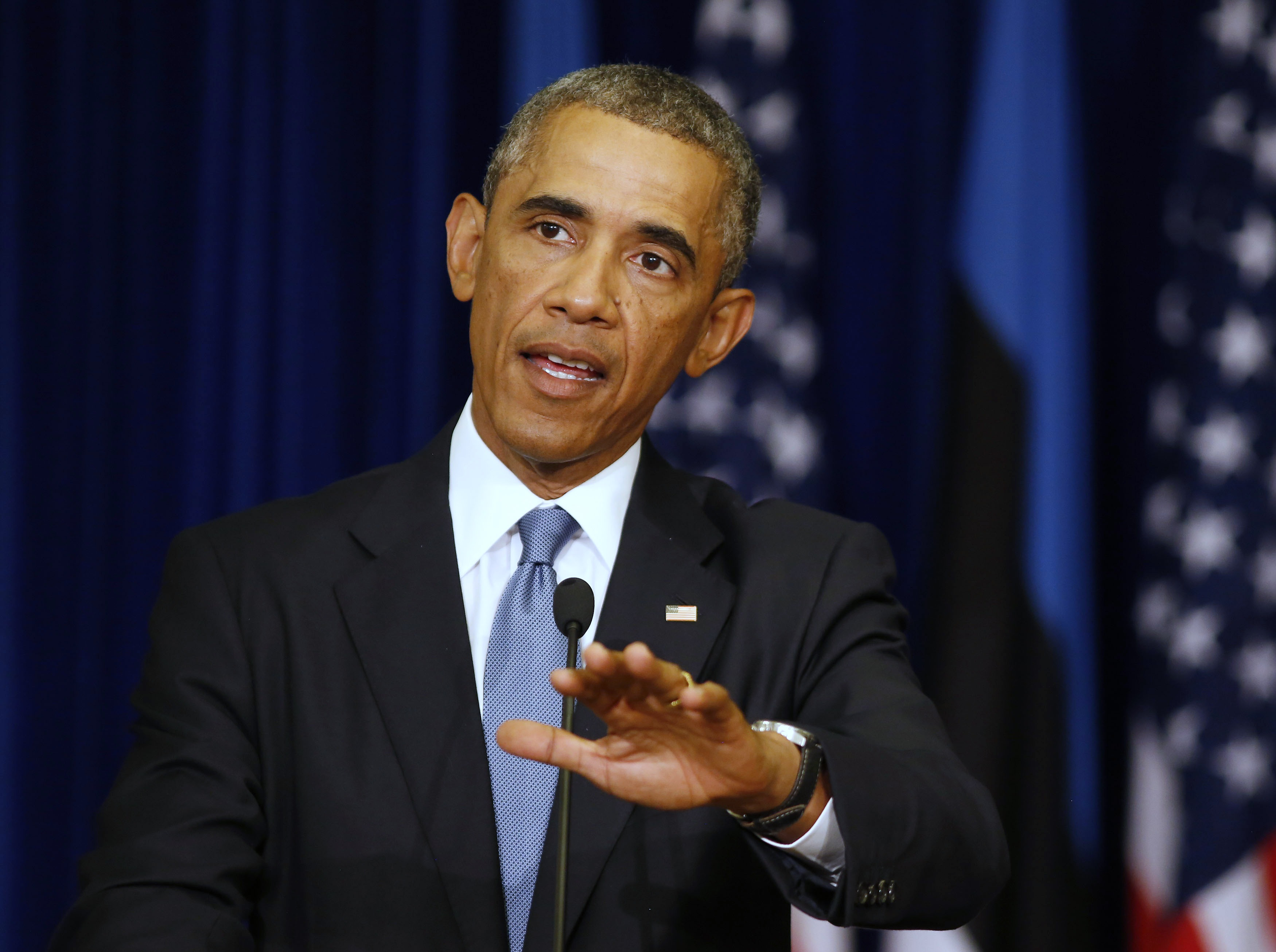 U.S. President Barack Obama gestures during a joint news conference with his Estonian counterpart Toomas Hendrik Ilves, at the Bank of Estonia in Tallinn September 3, 2014.     REUTERS/Larry Downing   (ESTONIA - Tags: POLITICS PROFILE)