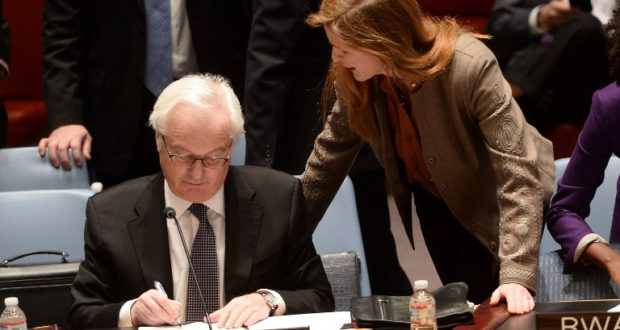 US Ambassador to the UN Samantha Power talks with her Russian counterpart Vitaly Churkin prior to a vote on a resolution on Ukraine during a UN Security Council emergency meeting at United Nations headquarters in New York on March 15, 2014. Russia vetoed a Western-backed resolution condemning the Crimea referendum at a UN Security Council emergency vote but China abstained, isolating Moscow further on the Ukraine crisis. The draft resolution, which says Sunday's referendum would have no validity, got 13 votes in the 15-member Council. But it was rejected when permanent member Russia exercised its veto.   AFP PHOTO/Emmanuel Dunand