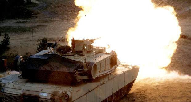 "A U.S. M1 Abrams tank fires during the ""Saber Strike"" NATO military exercise in Adazi, Latvia, June 11, 2016. REUTERS/Ints Kalnins - RTX2FN43"